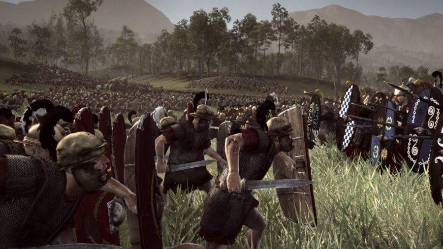 Une armée romaine charge une armée gauloise. Les deux côtés ont de très grands boucliers.